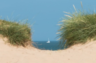 Lucky timing, just happened to walk up to the beach as this small boat was sailing past a gap in the bank.