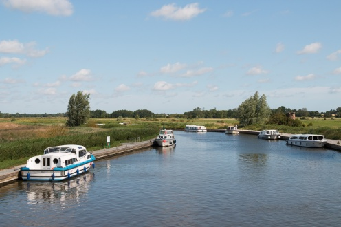 A few boats moored up on the River Ant at Ludham Bridge.