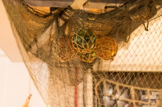 Hollow glass balls that were once used as floats for fishing nets. Photos of the historic lifeboats and fishing boats collection in Sheringham museum. (http://www.sheringhammuseum.co.uk)