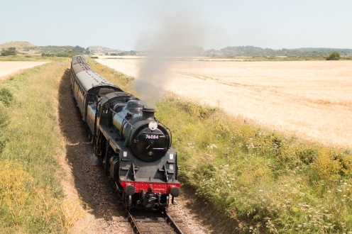 Steam locomotive 76084 pulling BR Suburban set carriages on the North Norfolk Railway. (Photos from National Trust Sheringham Park.)