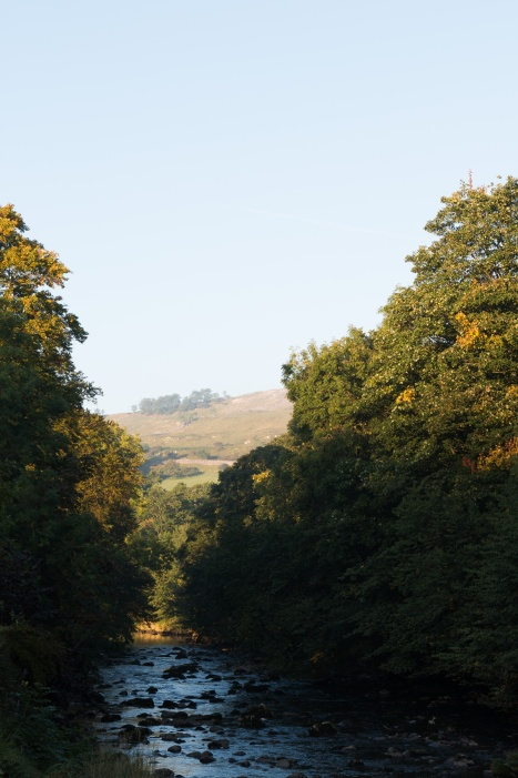 Morning sun lighting up the hills over the River Ribble at Langcliffe.
