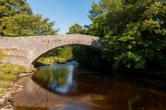 A narrow packhorse bridge over the Ribble at Stainforth.