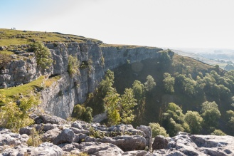 The curving cliffs of Malham Cove, where once a river would have flowed over the edge creating a large waterfall. These days the river from Malham Tarn disappears into underground caves before reaching the Cove. Photos taken at National Trust Malham Cove.