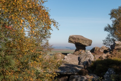 This rock formation, standing with a view over the valley, is called the Druid's Writing Desk. Photos of the rock formations at National Trust Brimham Rocks in North Yorkshire.