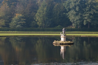 Statue of Neptune standing in the middle of the Moon Pond. Photos from National Trust Fountains Abbey and Studley Royal Water Garden, in North Yorkshire.