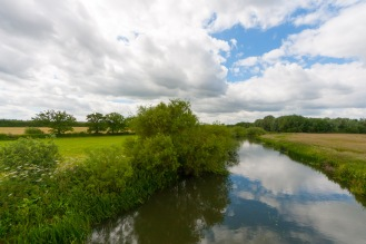 Reflections on the surface of the River Nene.