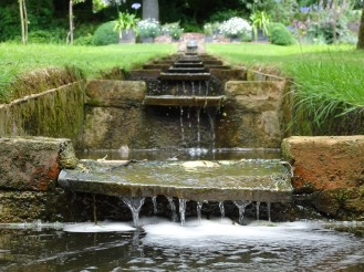 Water flowing over The Rill, running down through the garden orchards. Photos from a visit to Coton Manor Gardens in July 2017.